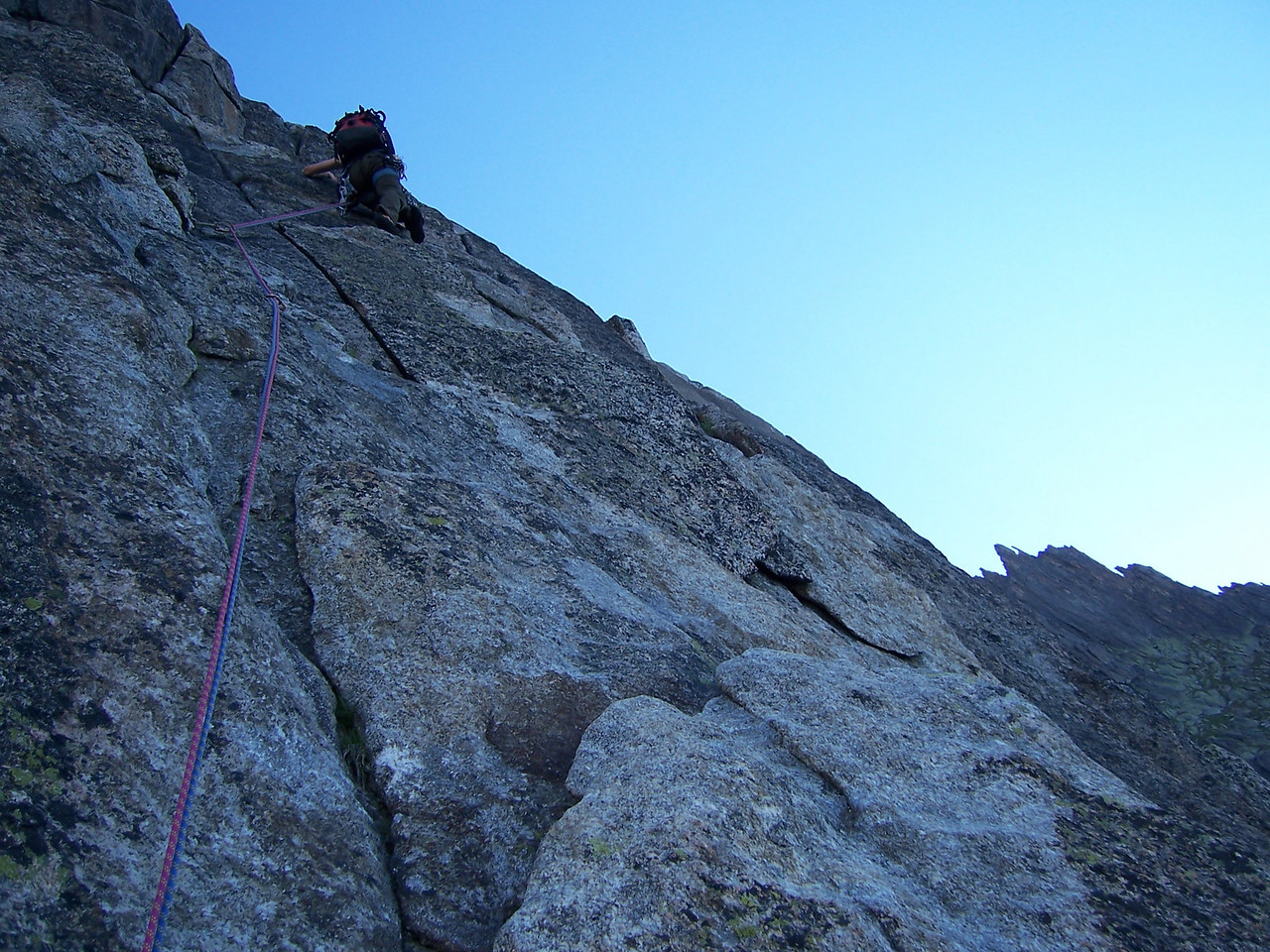 I got the first lead of the day, and one of the hardest ones.  A 6b (10d) mixed route is quite the warmup when your legs are still rubber from the night before and it's 6:30 in the a.m.!  Here Dan leads another pitch higher up on tower 1.