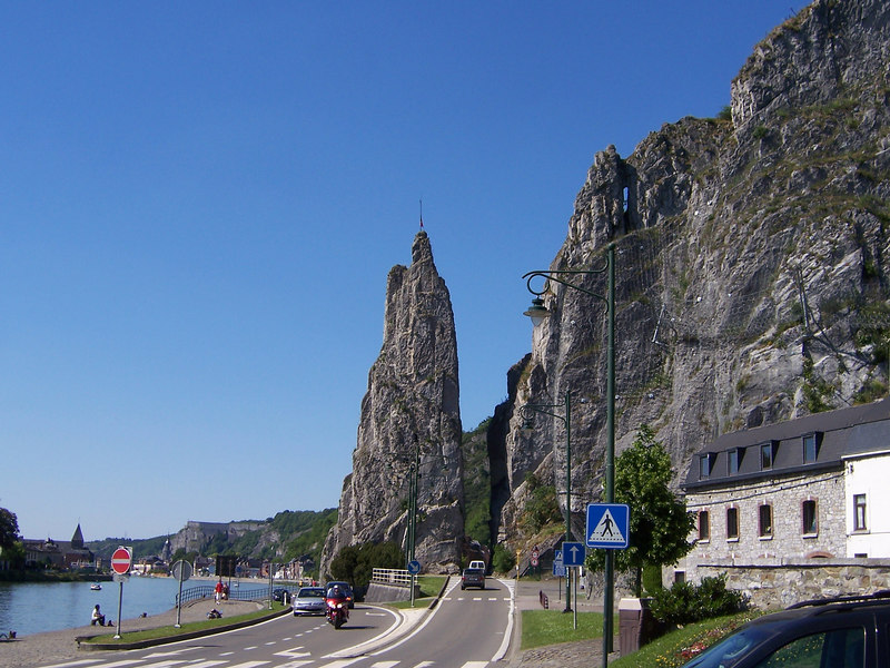 "This is the city of Dinant which stems from a word meaning ""divine valley"".  Dinant is very close to the Freyr crag."