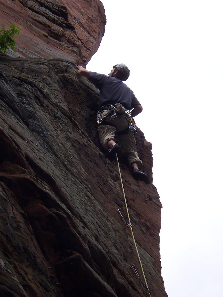 Quite alot of blank sandstone beneath me.  I threw in a nut and got onto the ledge and to the anchors.  Unfortunately it started to rain, so this route had to wait a few weeks to see me return.
