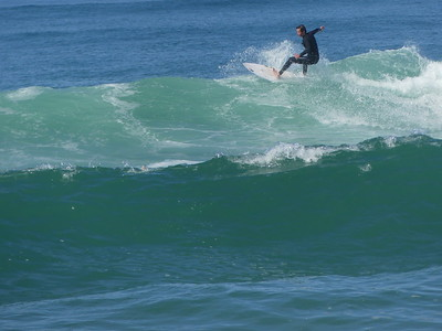 Surfer in the Bay of Biscay, near Pointe du Cap Ferret, on Bay of Biscay