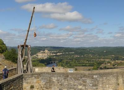 Trebuchet at Chateau Castelnaud, with Beynac-et-Cazenac in background, Dordogne Valley