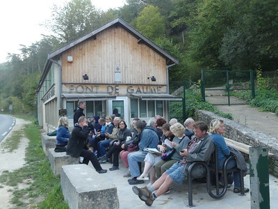 Tourists waiting to enter Font de Gaume, with prehistoric wall paintings, Dordogne