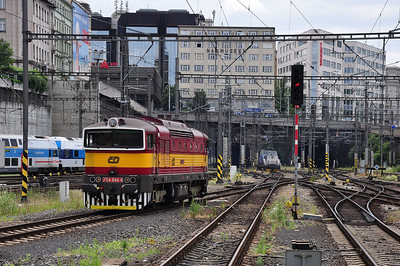 For many years an uncommon site in the capital but these days even 754s are allocated to Praha Vršovice. 754044 in heritage livery backing down onto R1254, 1745 Praha hl.n. - České Budějovice (04.07.2013)