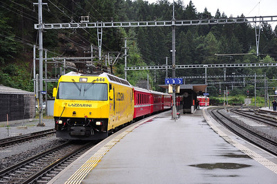 "644 in striking ""Lazzarini"" advertising livery at Reichenau-Tamins with train RE1124, 08.02 St. Moritz - Chur (25.08.2013)"