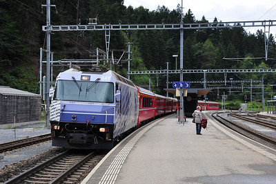 "649 in striking ""20 Minuten"" advertising livery at Reichenau-Tamins with train RE1140, 12.02 St. Moritz - Chur (25.08.2013)"