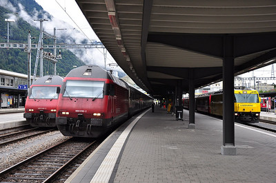 460049 and 460010 with SBB departures at Chur while RhB 644 has arrived with with train RE1124, 08.02 St. Moritz - Chur (25.08.2013)