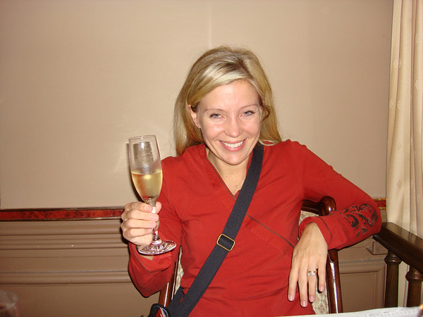 Cathy toasting our first night with a glass of champaign (quite tired after almost 20 hours of travel).
