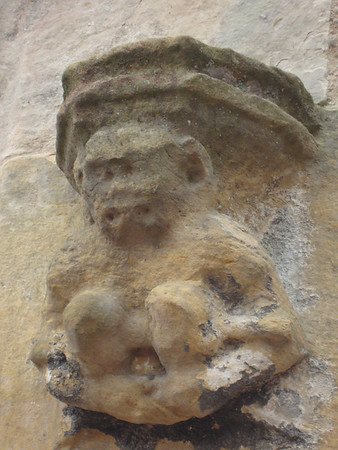 Rosslyn Chapel's monkey on the outside wall.