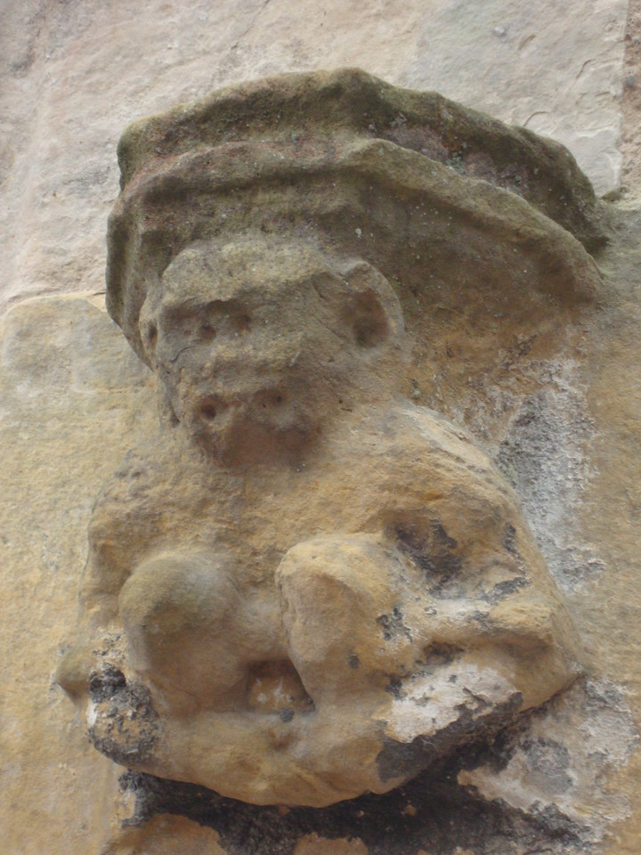 Rosslyn Chapel's monkey on the outside wall.