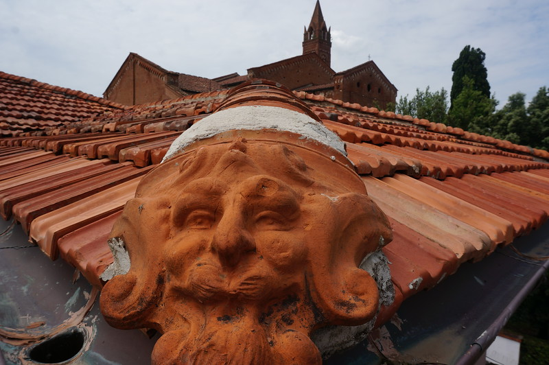 These are the start of the downspouts for the clay tile roofs. Easy to see when you are walking the wall. Pisa, Italy