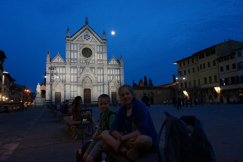 The family waiting outside their AirBNB in Florence Italy on the Piazza Santa Croce