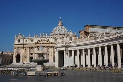 St. Peter's Basilica. The Vatican.  The statues on the colonnade are by Bernini.  The dome is by Michelangelo.