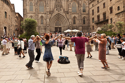 Barcelona, Spain Dancers on the square in front of Barcelona Cathedral.