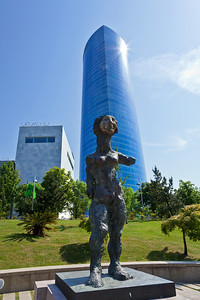 Bilbao, Spain The Judith sculpture by Markus Lüpertz along the Bilbao riverwalk. In the background is the city's tallest building, the Iberdrola building.