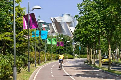 Bilbao, Spain The Abandoibarra Hirbidea parkway near the river walk in Bilbao. In the background is the Guggenheim Museum.