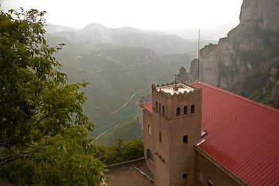 Montserrat, Spain The view  from the Benedictine abbey, Santa Maria de Montserrat on a hazy, rainy day on Montserrat mountain near Barcelona, Spain