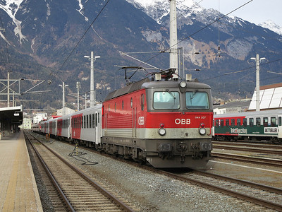 ÖBB 1144 207 / 1144 200 sit in the sidings at Innsbruck Hbf with the stock for this evenings REX5390 15.57 to Landeck Zams / REX5360 16.23 to Landeck Zams - 03/01/14.