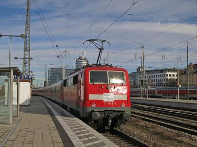 DB 111 049 (on hire to Meridian) dep München Ost, on rear of M79021 12.44 München-Salzburg (Vice EMU) - 06/01/14.
