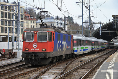 SBB Cargo 421380 (on hire to SOB) dep St Gallen, IR2414 10.05 to Luzern  - 22/03/14.
