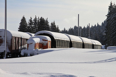 Small shunter and some 4-wheel passenger stock (part of the small railway museum here), well snowed in at Seebrugg  - 04/02/15.