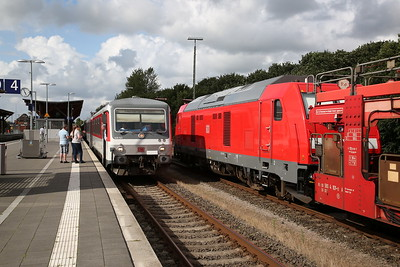 DB 628521, Niebüll, about to depart Southbound for Westerland by attaching to the rear of the next car shuttle .... 245023 alongside is for a later Car Shuttle - 05/08/17