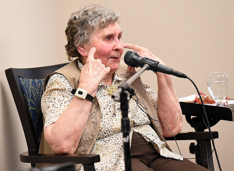 Eva Schumacher, a Good Samaritan Village resident, shares her story about her and her family's time in a Serbian war camp when she was young with Mountain View High students Tuesday, April 16, 2018, at Good Samaritan in Loveland.  (Photo by Jenny Sparks/Loveland Reporter-Herald)