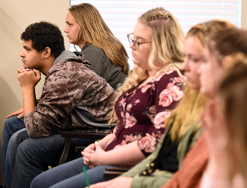 Mountain View High School student Kelly Meredith, 17, far left, listens as Eva Schumacher, a Good Samaritan Village resident, shares her story about her and her family's time in a Serbian war camp when she was young with Mountain View High students Tuesday, April 16, 2018, at Good Samaritan in Loveland.  (Photo by Jenny Sparks/Loveland Reporter-Herald)