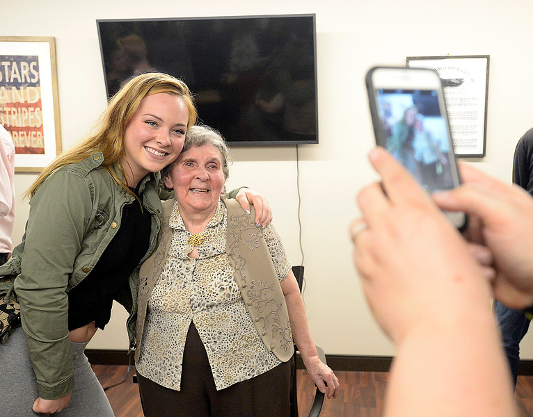Mountain view High School student Jackie Smith, 16, left, gets her photo taken with Eva Schumacher, a Good Samaritan Village resident, right, on Tuesday, April 16, 2018, after talking to students about her and her family's time in a Serbian war camp whne she was young.   (Photo by Jenny Sparks/Loveland Reporter-Herald)