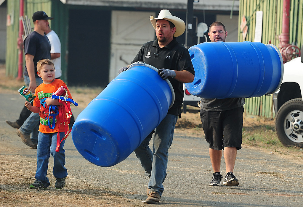 . VALLEJO, CA- OCT. 10, Donations of supplies are carried in to assist in taking care of the large animals evacuated from nearby fire areas.    (Chris Riley/Vallejo Times-Herald)