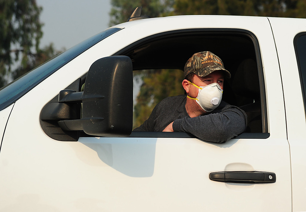 . VALLEJO, CA- OCT. 10, A volunteer wearing a face mask delivers supplies to the fairgrounds. (Chris Riley/Vallejo Times-Herald)