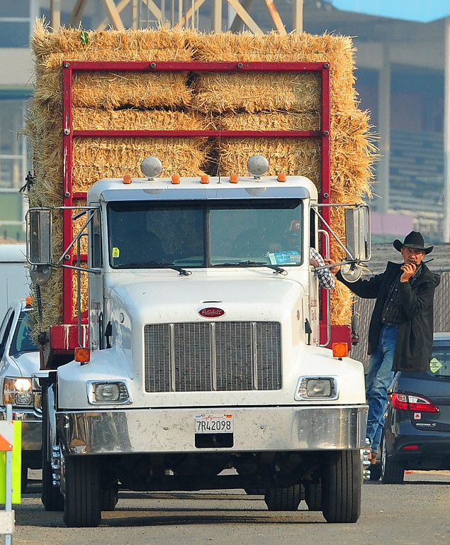 . VALLEJO, CA- OCT. 10, Shannon Kelsey of Napa directs a truck carrying a load of hay in to the large animal evacuation center. Kelsey had 51 of his horses at the facility.  (Chris Riley/Vallejo Times-Herald)