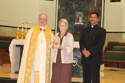 """Tip """"Eula"""" Crutchfield with Pastor Father Philip J. Panackal from Our Lady of Refuge."""