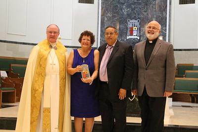 Joel and Ayme Morales with Pastor Father Hose Salazar from Nuestra Señora de San Juan de los Lagos, Madre de la Iglesia.