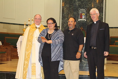 Roger and Elisa Cavazos with Pastor Father Anthony Blount, SOLT from St. Anthony of Padua.