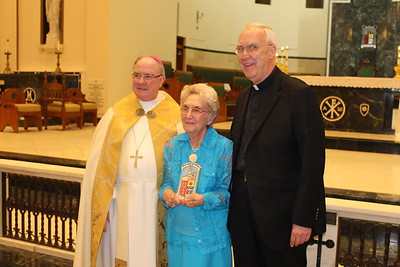 Olivia McDonald with Pastor Msgr. Roger Smith from St. Patrick in Corpus Christi.