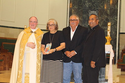 Ruben and Sarah Jo Anzaldua, Our Lady of Guadalupe in Alice with Pastor Father Julian Cabrera.