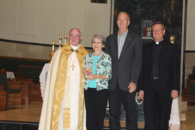 Allan and Patricia Cumberland with Pasto Father James Stumbler from St. Gertrude.