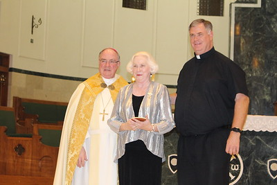 Brenda Evans with Pastor Father Bob Dunn from Most Precious Blood.
