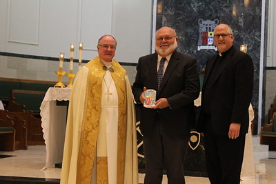Chuck Gross with Pastor Father Peter Hesse from St. Pius X in Corpus Christi.