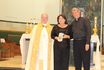 Cheryl Hooper with Pastor Msgr. Michael Howell from St. Andrew by the Sea.