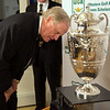 Jack Nicklaus looks for his name on the Western Amateur trophy before being honored at the Western Golf Association's Green Coat Gala at The Peninsula Chicago Hotel on Wednesday, Nov. 6, 2013.<br /> ©Charles Cherney Photography