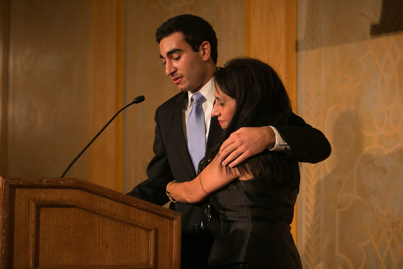 Evans Scholar Mark Abtahi with his mother Monad Bahrani<br /> Green Coat Gala at The Peninsula Hotel on Nov. 6, 2013<br /> ©Charles Cherney Photography