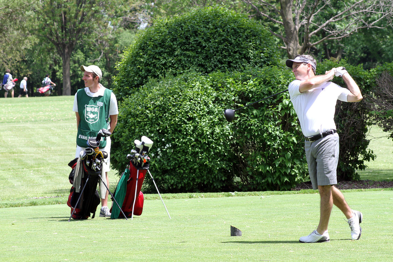 PGA TOUR golfer and Elmhurst resident, Mark Wilson, tees off at River Forest Country Club Evans Scholars Day in Elmhurst, Ill., on Tuesday, May 21. The event raised money for the Chick Evans Caddie Scholarship, a full tuition and housing scholarship for golf caddies.