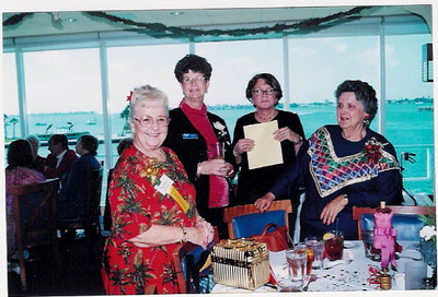 members Dolly Haerr, Carolyn Peterson, Suzanne Goldman and Helaine Eckstein chat, with the beautiful Sarasota Bay in the background