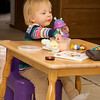 Eve having a snack at a table that once belonged to her Mom
