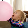 Eve trying to swallow a balloon