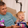 Eve enjoying a snack with Grandpa