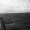 Nearby ship at sea.