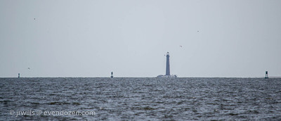 Sand Island lighthouse seen through the afternoon haze.