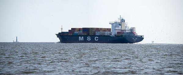 This is several photos stitched together. I hoped for more detail in the container ship and background. I'm not too disappointed with the results.